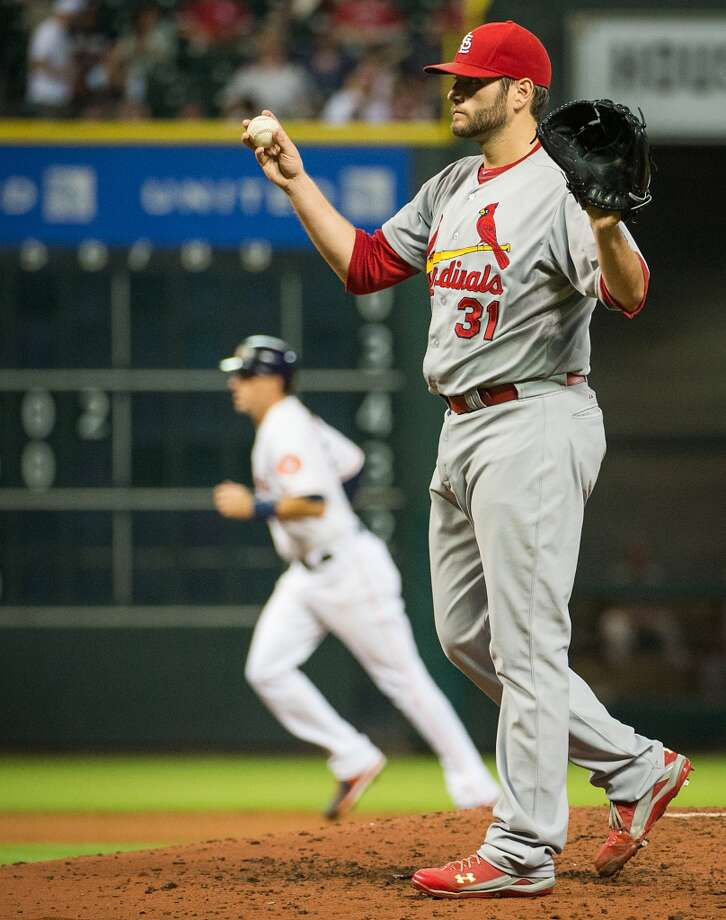 Cardinals starting pitcher Lance Lynn calls for a new ball after issuing a bases-loaded walk to Carlos Pena.