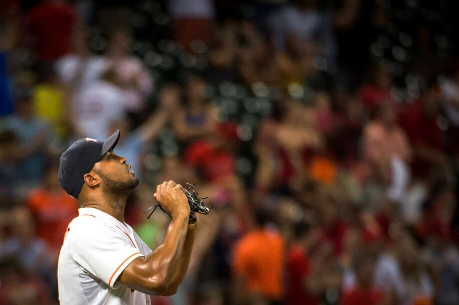 Astros relief pitcher Jose Veras celebrates after the final out of the Astros victory over the Cardinals.