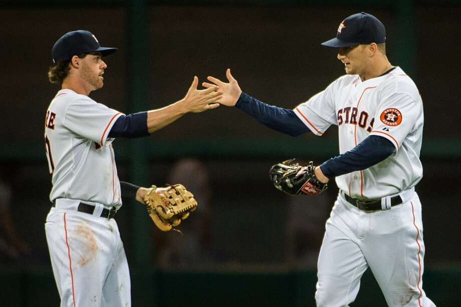 Astros center fielder Brandon Barnes, left, celebrates with Jake Elmore after the final out of the Astros victory over the Cardinals.