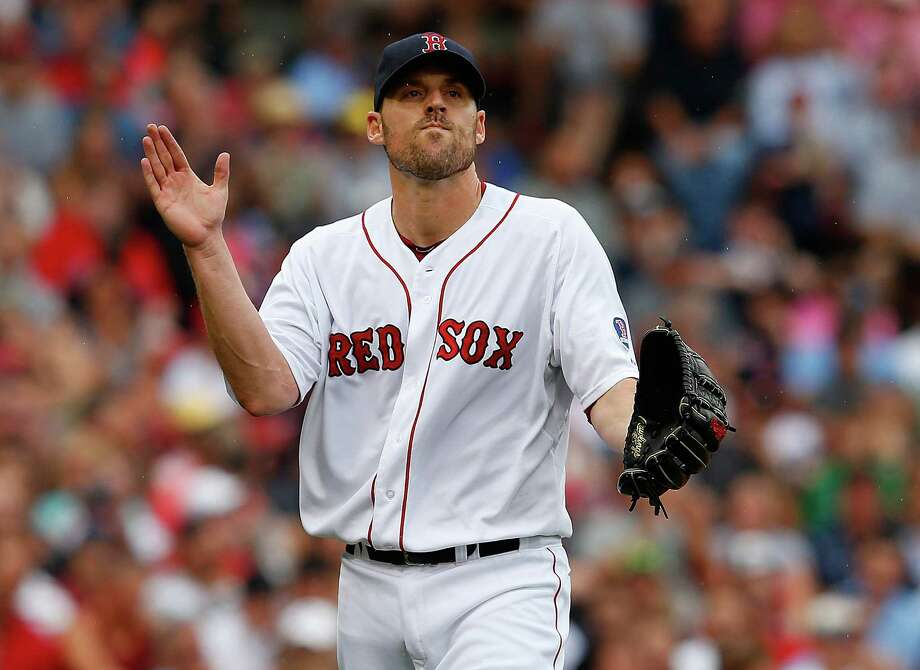 BOSTON, MA - JUNE 26: John Lackey #41 of the Boston Red Sox reacts after getting out of trouble in the 4th inning against the Colorado Rockies at Fenway Park on June 26, 2013 in Boston, Massachusetts.  (Photo by Jim Rogash/Getty Images) ORG XMIT: 163494270 Photo: Jim Rogash / 2013 Getty Images
