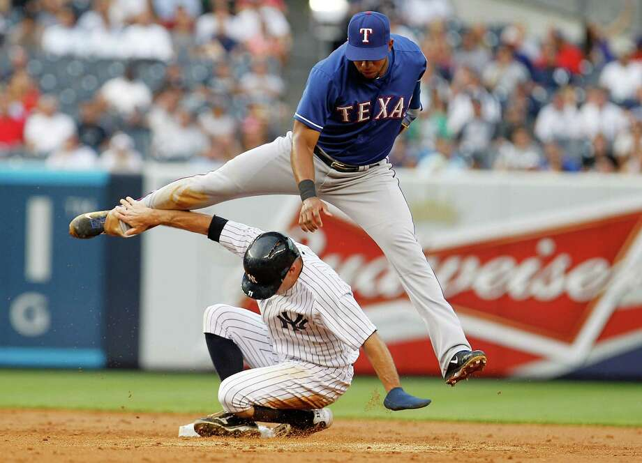 NEW YORK, NY - JUNE 26:  Brett Gardner #11 of the New York Yankees is forced out at second as Elvis Andrus #1 of the Texas Rangers completes the double play at Yankee Stadium on June 26, 2013 in the Bronx borough of New York City.  (Photo by Mike Stobe/Getty Images) ORG XMIT: 163494265 Photo: Mike Stobe / 2013 Getty Images