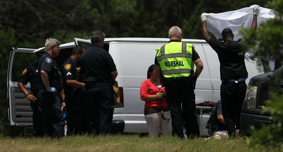 Police work the scene where Zachary Day, 29, died on Interstate 10. The son of Dr. Day stopped his vehicle along the interstate and then stepped in front of an 18-wheeler. Photo: John Davenport / San Antonio Express-News