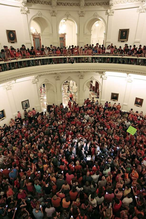 AUSTIN, TX - JUNE 25: Reproductive rights advocates fill the Texas capitol rotunda celebrating the defeat of the controversial anti-abortion bill SB5, which was up for a vote on the last day of the legislative special session June 25, 2013 in Austin, Texas. A combination of State Sen. Wendy Davis' (D-Ft. Worth) 13-hour filibuster and protests by reproductive rights advocates helped to ultimately defeat the controversial abortion legislation at midnight. (Photo by Erich Schlegel/Getty Images) Photo: Erich Schlegel, Getty Images