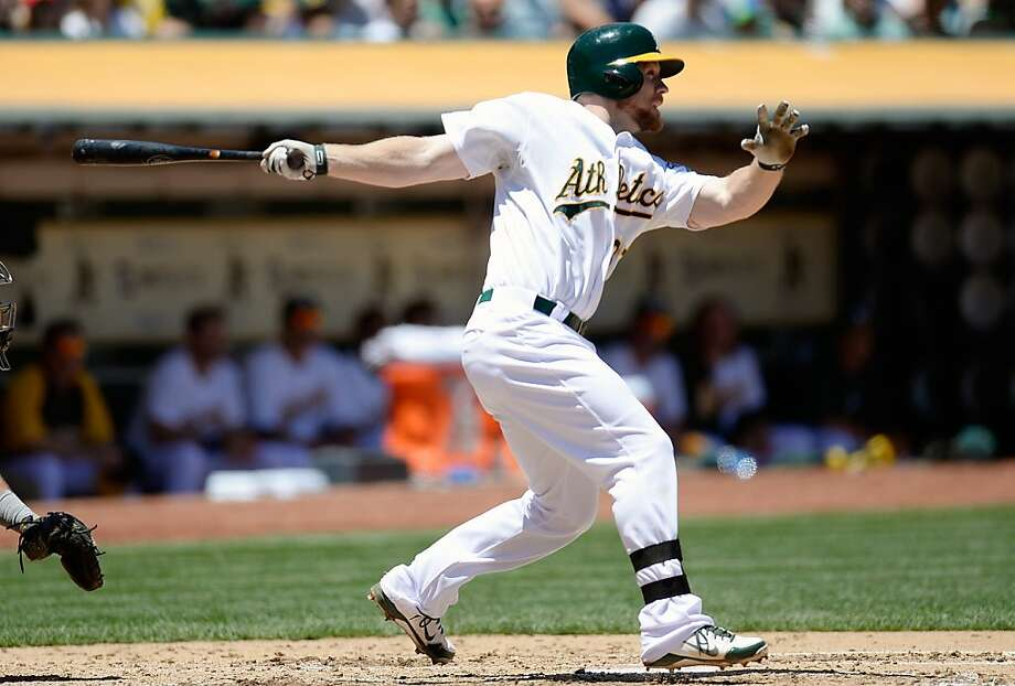 OAKLAND, CA - JUNE 26:  Brandon Moss #37 of the Oakland Athletics hits an RBI double scoring Jed Lowrie #8 in the fourth inning against the Cincinnati Reds at O.co Coliseum on June 26, 2013 in Oakland, California.  (Photo by Thearon W. Henderson/Getty Images) Photo: Thearon W. Henderson, Getty Images