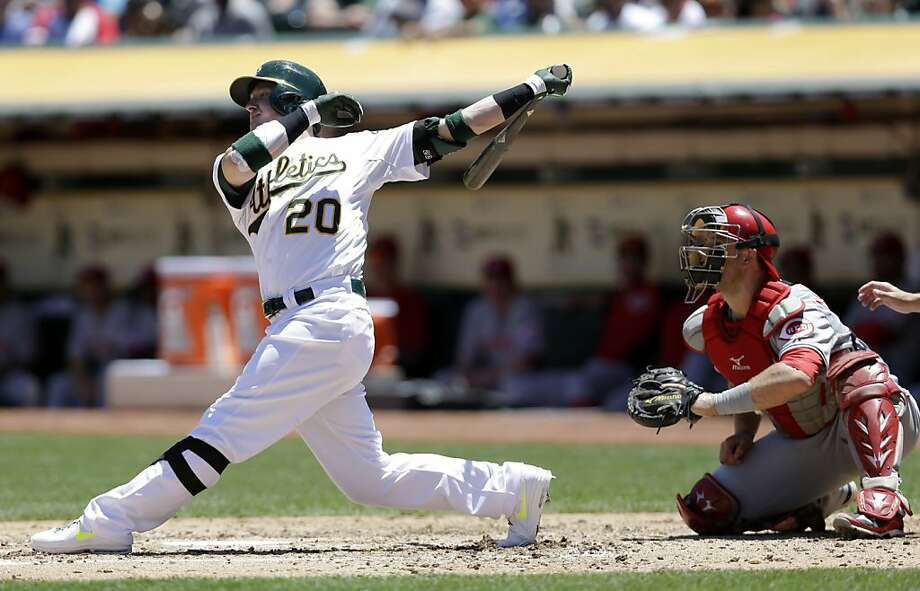 Oakland Athletics' Josh Donaldson follows through on a three-run home run against the Cincinnati Reds during the fourth inning of a baseball game Wednesday, June 26, 2013, in Oakland, Calif. (AP Photo/Marcio Jose Sanchez) Photo: Marcio Jose Sanchez, Associated Press