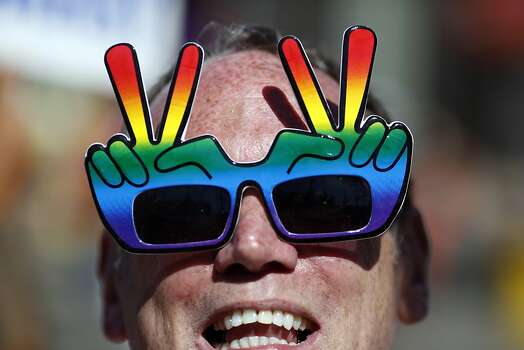 Joe Mac shouts and cheers while wearing rainbow peace sign sunglasses during celebrations in the Castro in San Francisco, Calif. on June 26, 2013. Photo: Ian C. Bates, The Chronicle