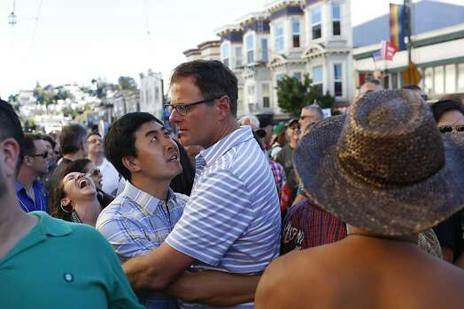 Jialim Gao, left, and Jay Wehr, right, embrace during a song played during celebrations in the Castro in San Francisco, Calif. on June 26, 2013. Photo: Ian C. Bates, The Chronicle
