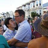 Jialim Gao, left, and Jay Wehr, right, embrace during a song played during celebrations in the Castro in San Francisco, Calif. on June 26, 2013.