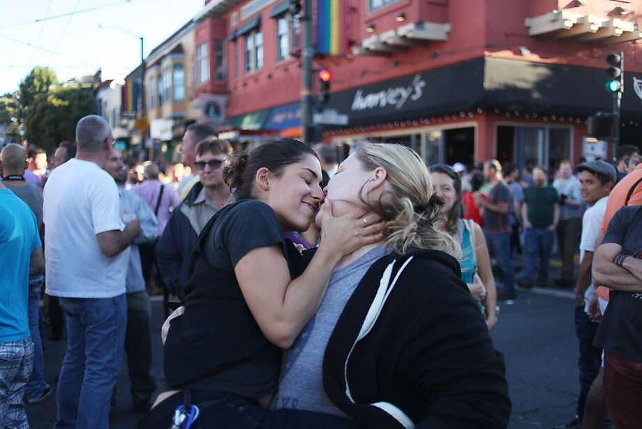 Katie DeCarlo, left, and Chelsea Peterson kiss during a celebration of the Supreme Court's ruling on Proposition 8 and DOMA on June 27, 2013 in the Castro neighborhood of San Francisco, Calif. With the court's ruling, gay marriage will again be legal in San Francisco. Photo: Pete Kiehart, The Chronicle