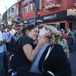 Katie DeCarlo, left, and Chelsea Peterson kiss during a celebration of the Supreme Court's ruling on Proposition 8 and DOMA on June 27, 2013 in the Castro neighborhood of San Francisco, Calif. With the court's ruling, gay marriage will again be legal in San Francisco.
