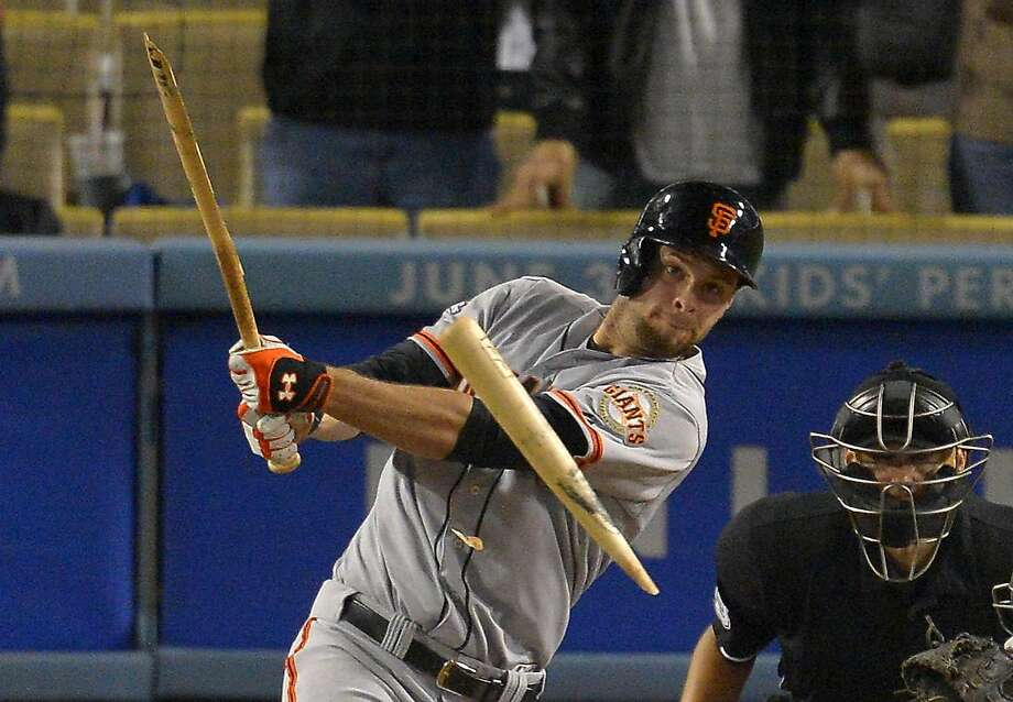 Brandon Belt's bat breaks apart on contact in a 2013 game. Bats are now breaking on any pitch regardless of location. Photo: Mark J. Terrill, Associated Press