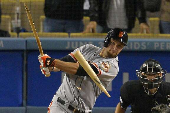 San Francisco Giants' Brandon Belt breaks his bat as he pops out to end the game in the ninth inning of their baseball game against the Los Angeles Dodgers, Wednesday, June 26, 2013, in Los Angeles. (AP Photo/Mark J. Terrill)