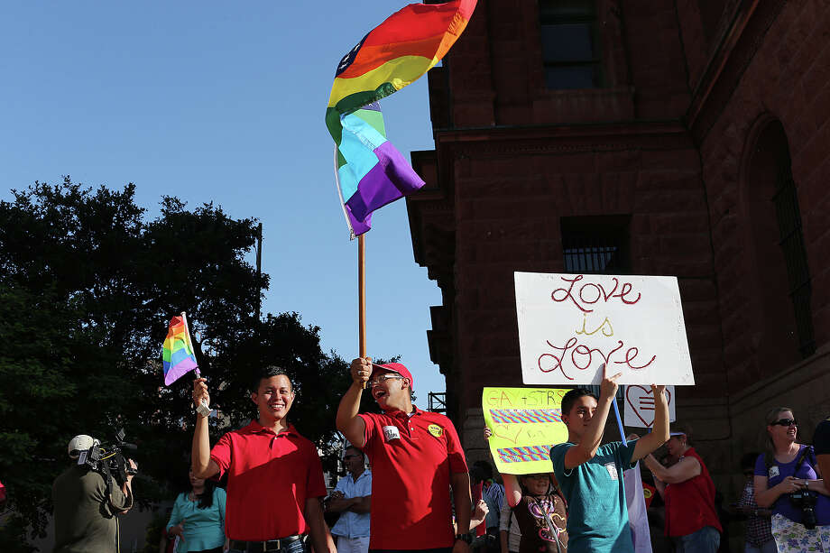 "From left, Michael Torres, 20, Julius Lorenzi, 19 and Emmett Gonzalez, 19, celebrate with other supporters during  ""The Day of Decision"" rally in front of the Bexar County Courthouse, Wednesday, June 26, 2013. The rally was in celebration of the U.S. Supreme Court decision striking down the Defense of Marriage Act. It was organized by the Local Human Rights Campaign and GetEQUAL TX. Photo: JERRY LARA, San Antonio Express-News / © 2013 San Antonio Express-News"
