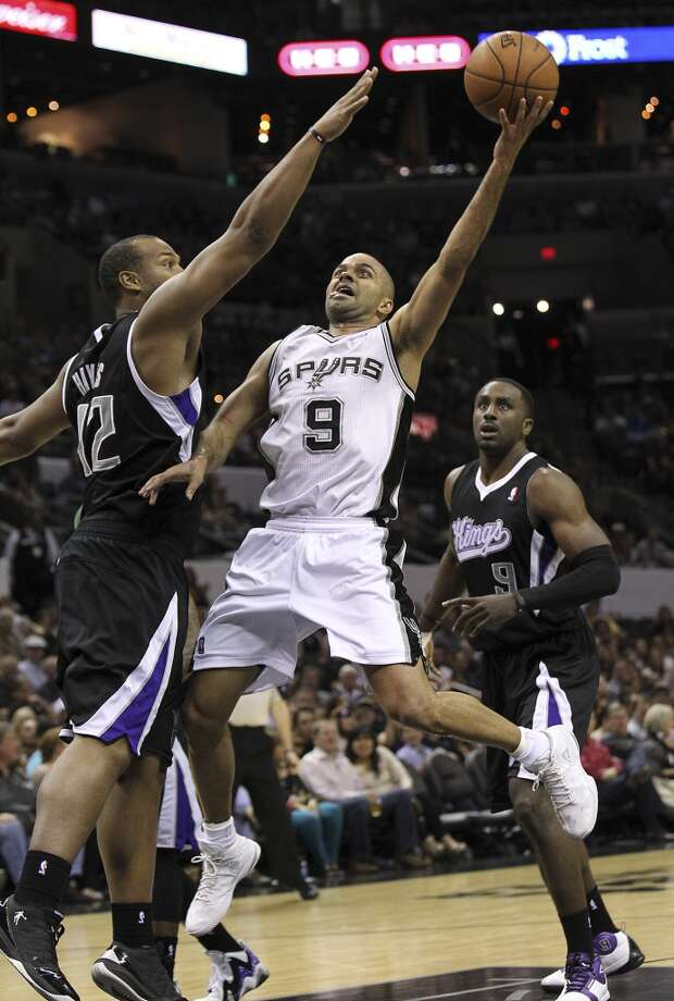 Spurs' Tony Parker (09) extends for a shot against Sacramento Kings' Chuck Hayes (42) in the second half at the AT&T Center on Friday, Apr. 12, 2013. Spurs defeated the Kings, 108-101.