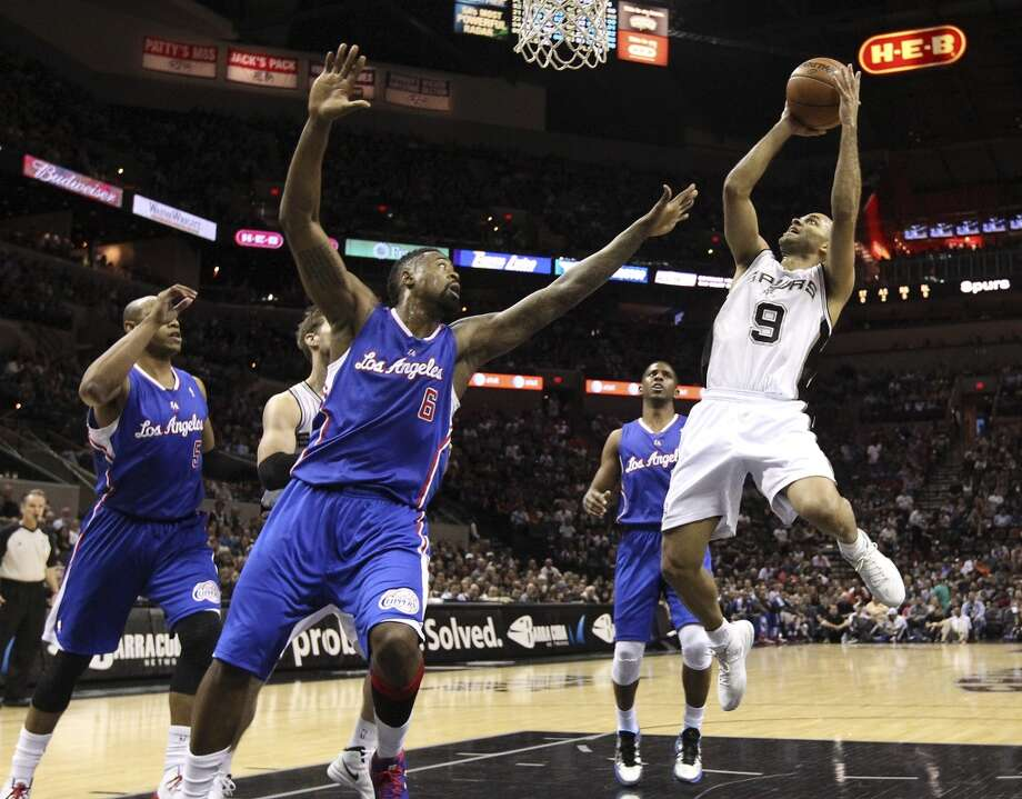 Spurs' Tony Parker (09) takes a short jumper against Los Angeles Clippers' DeAndre Jordan (06) in the first quarter at the AT&T Center on Friday, Mar. 29, 2013.