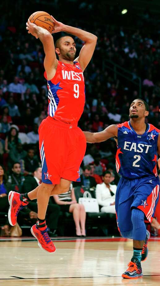 The West's Tony Parker passes over the East's Kyrie Irving during first half action of the 62nd NBA All-Star Game at the Toyota Center on Sunday, Feb. 17, 2013 in Houston. Photo: Edward A. Ornelas, San Antonio Express-News / © 2013 San Antonio Express-News