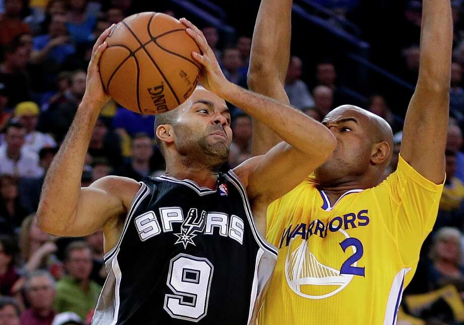 The Spurs' Tony Parker (9) looks to pass away from Golden State Warriors' Jarrett Jack during the second half Friday, Feb. 22, 2013, in Oakland, Calif. Photo: Ben Margot, Associated Press / AP