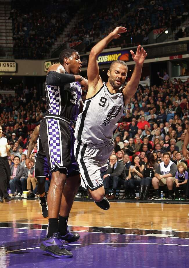 Tony Parker (9) of the Spurs falls to the crowd after colliding with Jason Thompson (34) of the Sacramento Kings on Feb. 19, 2013 in Sacramento. Photo: Ezra Shaw, Getty Images / 2013 Getty Images