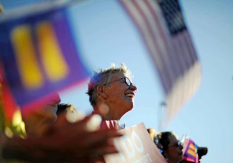 WEST HOLLYWOOD, CA - JUNE 26:  Same-sex marriage supporters celebrate the US Supreme Court ruling during a community rally on June 26, 2013 in West Hollywood, California. The Supreme Court struck down the Defense of Marriage Act (DOMA) and ruled that supporters of California's ban on gay marriage, Proposition 8, could not defend it before the Supreme Court.  (Photo by Kevork Djansezian/Getty Images) Photo: Kevork Djansezian, Getty Images