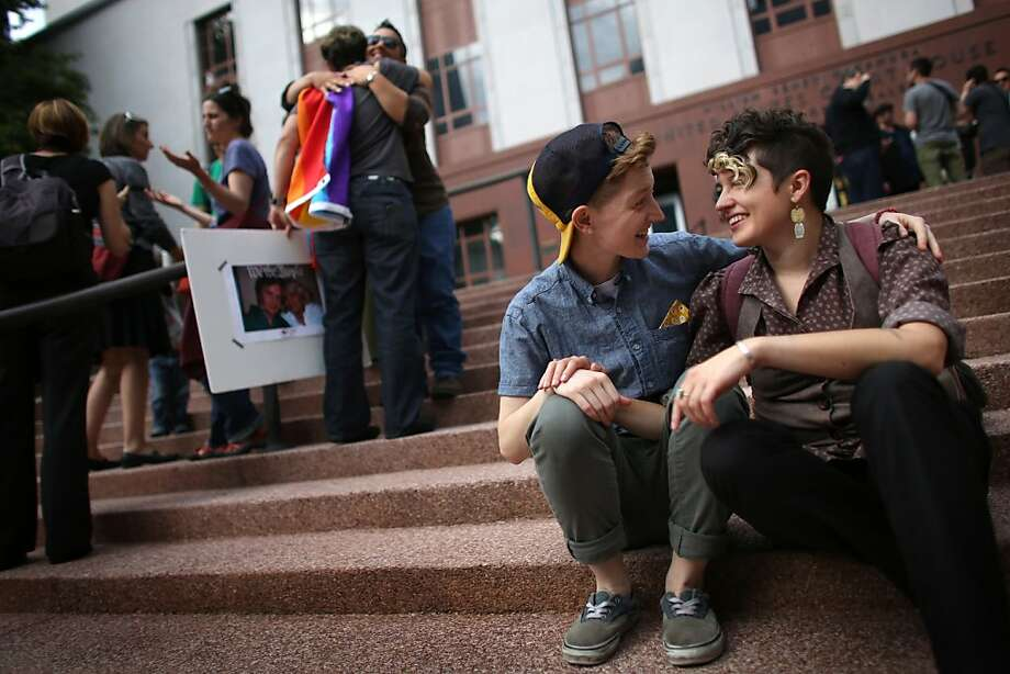 Ander Lyon, left, and Lana McMullen sit on the steps of the William Kenzo Nakamura United States Court of Appeals in downtown Seattle as hundreds gathered there on Wednesday, June 26, 2013 after the United States Supreme Court struck down the Defense of Marriage Act and dismissed California's Proposition 8. The couple, who are not married, said the law may benefit them in the future. (Associated Press/seattlepi.com, Joshua Trujillo) Photo: Joshua Trujillo, Associated Press