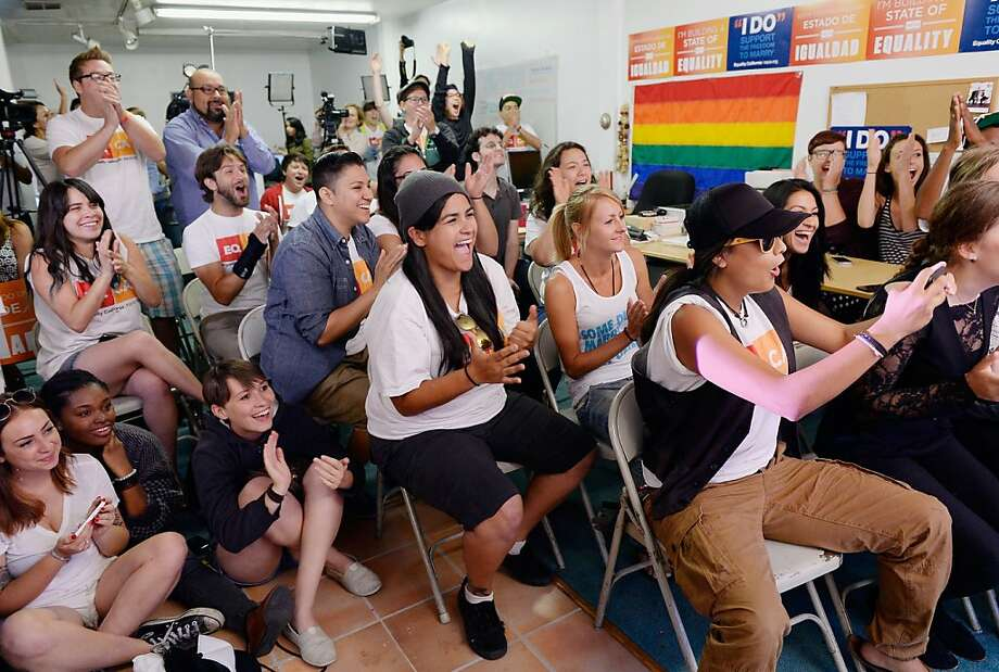 WEST HOLLYWOOD, CA - JUNE 26:  Martha Acevedo (C), 25, reacts with other to the Supreme Court ruling at a watch party at Equality California, a non-profit civil rights organization that advocates for the rights of LGBT people in California, on June 26, 2013 in West Hollywood, California. The high court struck down the Defense of Marriage Act (DOMA) and ruled that supporters of California's ban on gay marriage, Proposition 8, could not defend it before the Supreme Court. (Photo by Kevork Djansezian/Getty Images) Photo: Kevork Djansezian, Getty Images