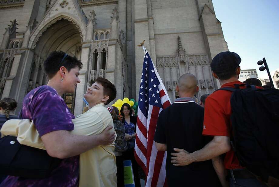L-R, Julie Galles holds her fiancé Megan Stansbery as Frank and Joe Capley_Alfano embrace after a press conference at Grace Cathedral in San Francisco, Calif., on Wednesday, June 26, 2013. Dozens of Bay Area religious leaders in support of same-sex marriage gathered at Grace Cathedral for a press conference following the Supreme Court's decision on Proposition 8 earlier in the morning. Photo: Carlos Avila Gonzalez, The Chronicle