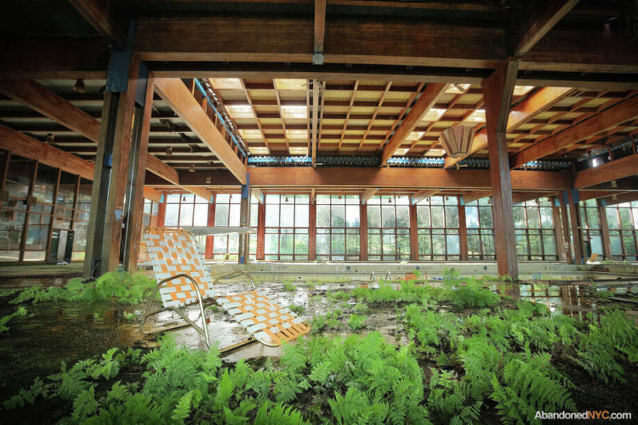 Lawn chair with view of resort's return to nature. Photo via AbandonedNYC. http://abandonednyc.com