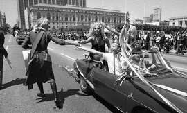 June 25, 1972: A convertible approaches SF City Hall during the first Gay Freedom Day Parade. The Chronicle reported 2,000 participants marched 22 blocks, with a few thousand more spectators.