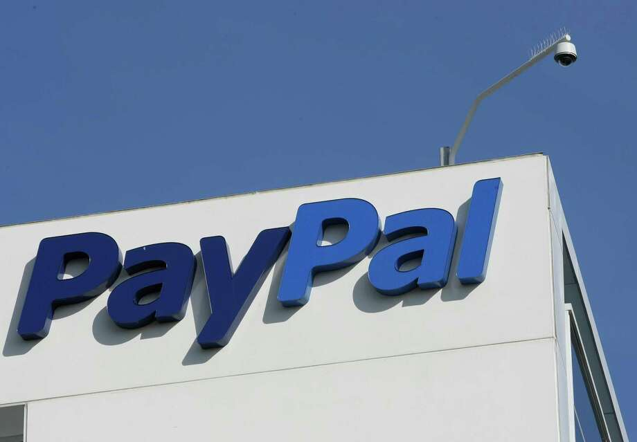 FILE - This Jan. 19, 2011 file photo shows the eBay/PayPal offices in San Jose, Calif. PayPal, which is eBay Inc.'s payments business, says it is launching an initiative called PayPal Galactic with the help of the nonprofit SETI Institute in Mountain View, Calif., and the Space Tourism Society, an industry group focused on space travel. Its goal, PayPal says, is to work out how commerce will work in space. Photo: Paul Sakuma