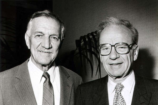 News media baron Rupert Murdoch (right) with then-Express-News Publisher Charles O. Kilpatrick in 1990.