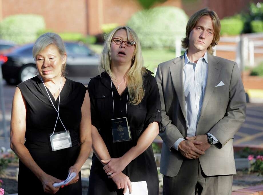 Donna Aldred, left, her daughter Leslie Lambert, center, and Lambert's husband Darrel Lambert, right, listen during a news conference after the execution of Kimberly McCarthy at the Texas Department of Criminal Justice Huntsville Unit, where the death chamber is located, Wednesday, June 26, 2013, in Huntsville, Texas. Aldred's mother, Dorothy Booth, was killed by Kimberly McCarthy in 1997. McCarthy was executed Wednesday, making her the 500th person executed in Texas since 1982. (AP Photo/David J. Phillip) Photo: David J. Phillip, STF / AP