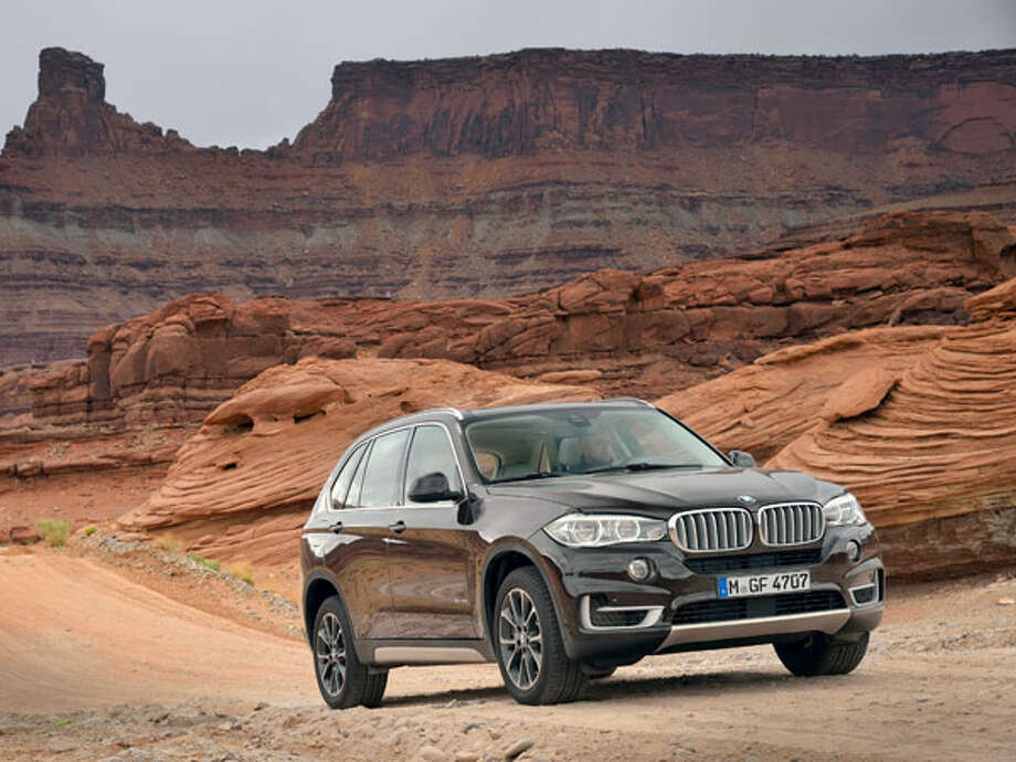 2014 BMW X5The third-generation of BMW's X5 SUV—sorry, Sport Activity Vehicle in BMW parlance—is scheduled to arrive before the end of 2013 after an official debut at September's Frankfurt Auto Show. We know a lot about this new X5 right now, however, including the coming first-time-ever option of a rear-wheel-drive X5, and a turbocharged diesel X5 expected in the first quarter of 2014. The X5 will be greeted by a more fractious, subsegmented, and highly competitive luxury SUV market than ever before; by offering a multitude of powertrains and interior options (the choice of a 40/20/40 or 70/30 rear bench, for example) BMW hopes to draw customers away from less flexible rivals.