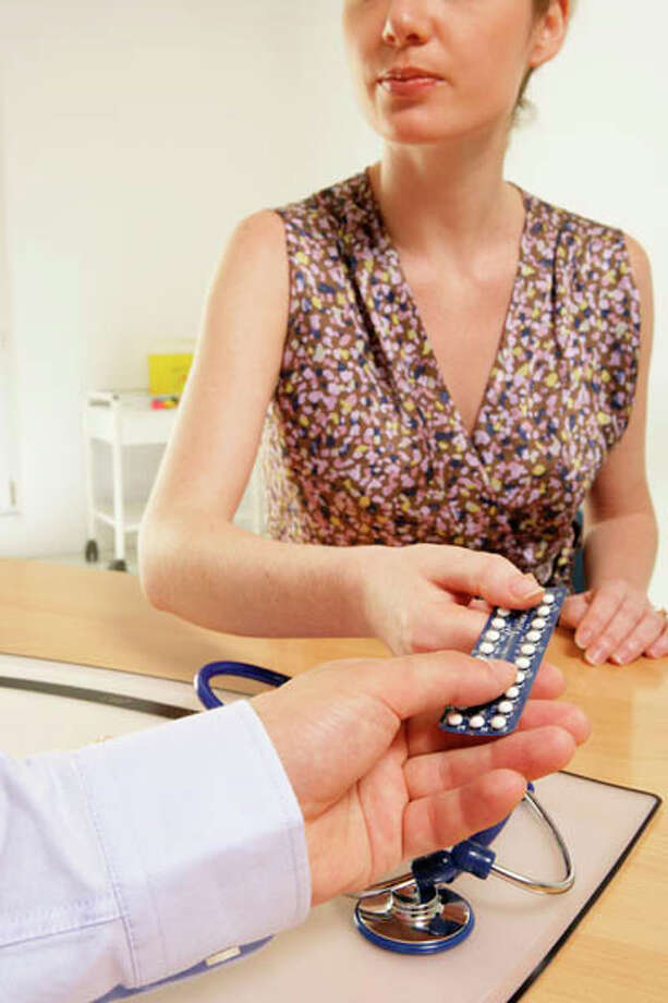 Doctor showing patient birth control pills. Photo: BSIP/UIG, Getty Images/Universal Images Group / Universal Images Group