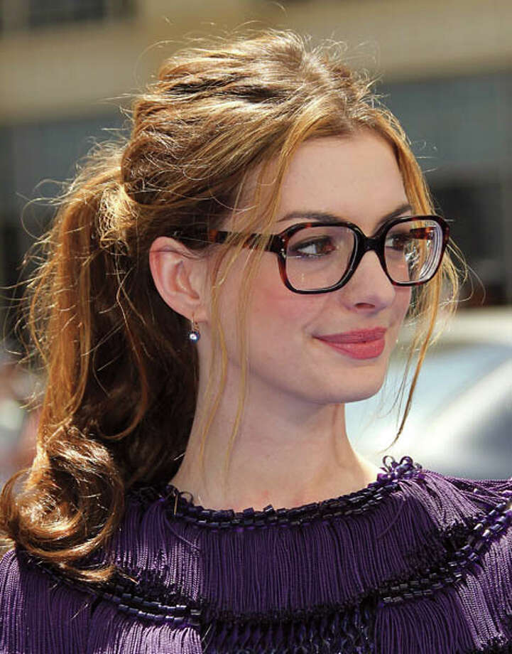"HOLLYWOOD, CA - APRIL 10: Actress Anne Hathaway attends the premiere of Twentieth Century Fox and Blue Sky Studios' ""Rio"" at Grauman's Mann Chinese Theater on April 10, 2011 in Hollywood, California.  (Photo by Frederick M. Brown/Getty Images) *** Local Caption *** Anne Hathaway Photo: Frederick M. Brown, Getty Images / 2011 Getty Images"