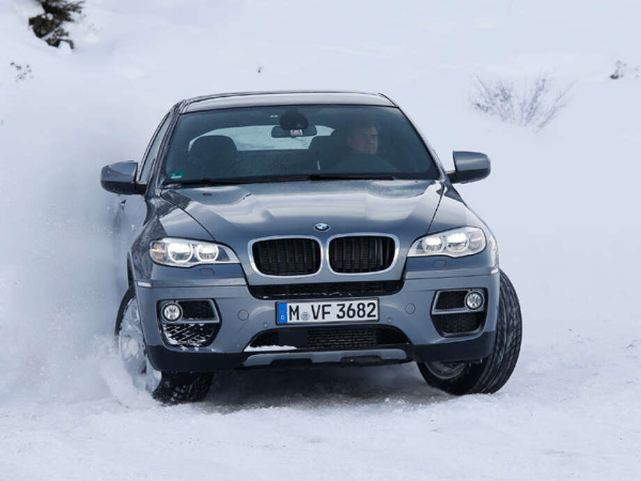 2014 BMW X7With a new X5 set to roll out, BMW appears ready to debut a brand-new, larger luxury Sports Activity Vehicle. Recent spy photos have caught a big BMW SUV on the road, with a test driver allegedly calling the vehicle a 2014 X7. So far that's all we know for sure about the X7, so the rest is speculation: trim levels, engine options, M-Sport package—we can likely expect these, but we don't know for sure. Potentially more interesting is that the success of an X7 might see a Rolls Royce SUV built on the same platform, which would melt the eyes of luxury-sedan purists the world over. Photo: Fabian Kirchbauer