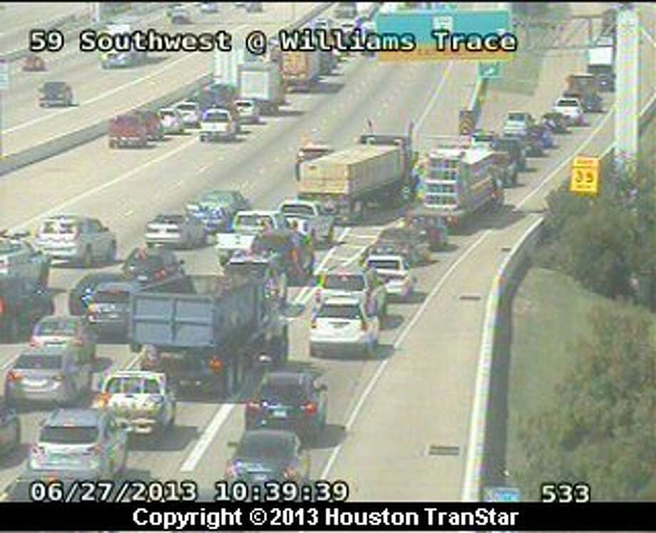 Portions of southbound U.S. 59 were temporarily shutdown after a vehicle fire near Williams Trace. Photo: Houston Transtar
