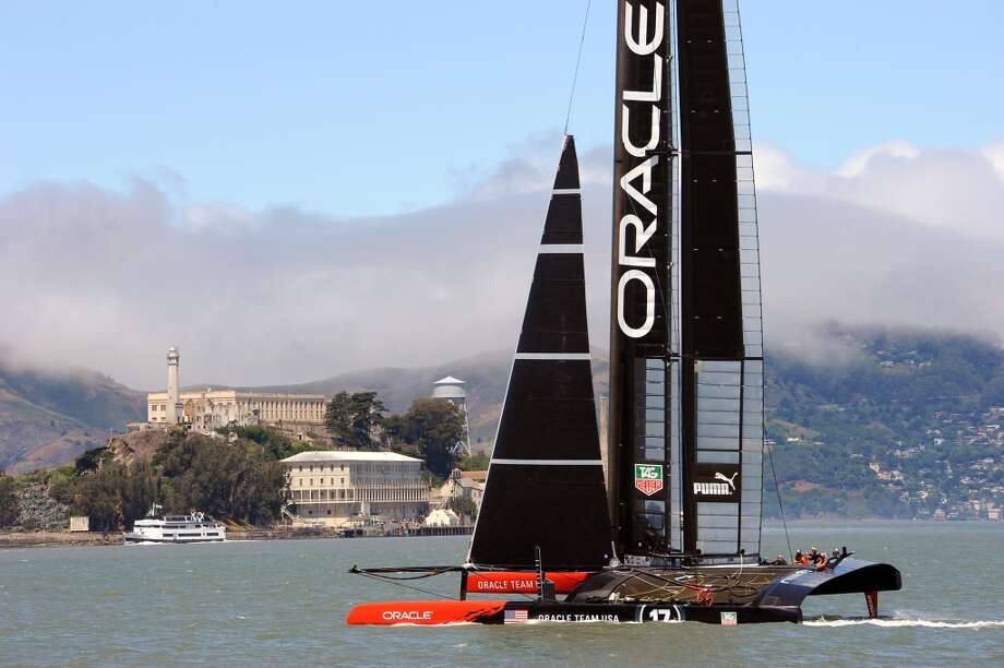 Oracle Team USA ran out 2 of it's AC-72 catamarans in San Francisco Bay Wednesday June 26th, 2013, as crews ramped up their training for the upcoming America's Cup finals in September. Photo: Michael Short, Special To The Chronicle