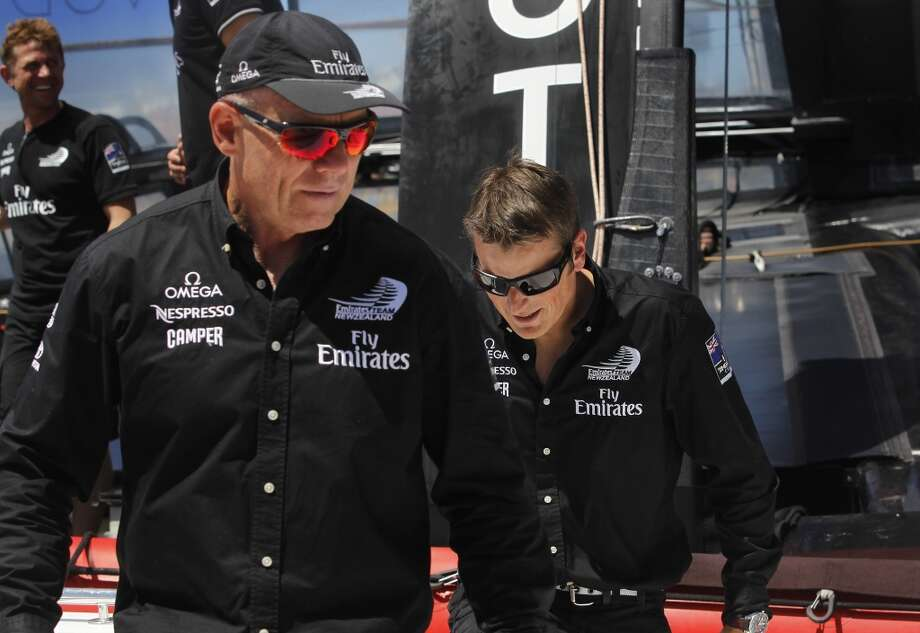 Grant Dalton (left), managing director of the Emirates Team New Zealand AC-72 boat, and his skipper, Dean Barker, disembark after inspecting the catamaran at the team's compound before a training session in San Francisco, Calif. on Wednesday, June 26, 2013. New Zealand squares off against Italy's Luna Rossa and Artemis Racing of Sweden in the Louis Vuitton Cup with the winner earning the right to challenge Oracle Team USA, the defender of the America's Cup. Photo: Paul Chinn, The Chronicle
