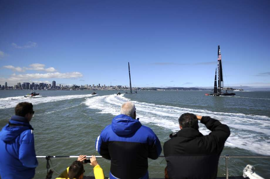 Guests on a chase boat watch as Oracle Team USA ran out 2 of it's AC-72 catamarans in San Francisco Bay Wednesday June 26th, 2013, as crews ramped up their training for the upcoming America's Cup finals in September. Photo: Michael Short, Special To The Chronicle