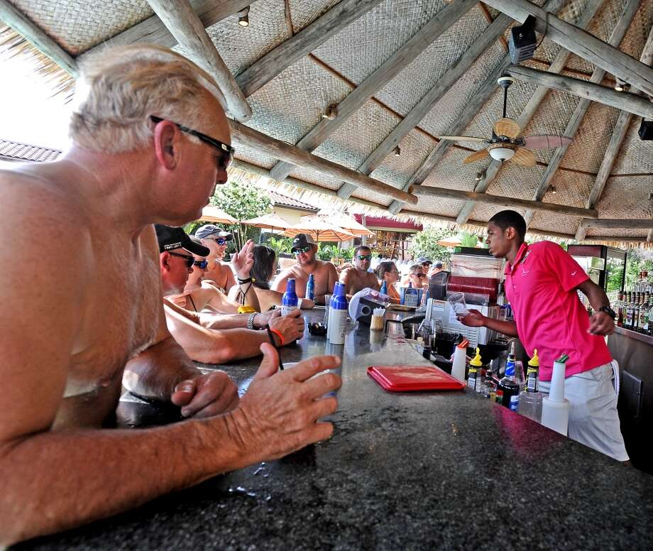The pool bar gets going before the L'auberge Casino Resort Liquid Society party by the pool which will continue every Thursday through August 29. Photo taken: Randy Edwards/The Enterprise