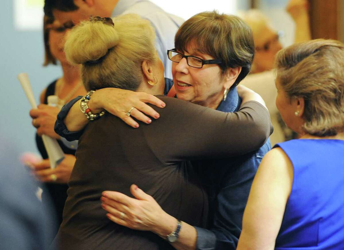 Retiring teachers Barbara Fortunato, left, and Nancy Berman share a hug at the Danbury Public Schools teacher retirement reception at the Danbury Schools Administrative Office in Danbury, Conn. on Wednesday, June 26, 2013. Fortunato taught for 35.9 years, retiring as the kindergarten teacher at Park Ave. Elementary, and Berman taught for 28 years, retiring as the reading teacher at the Alternative Center for Excellence.