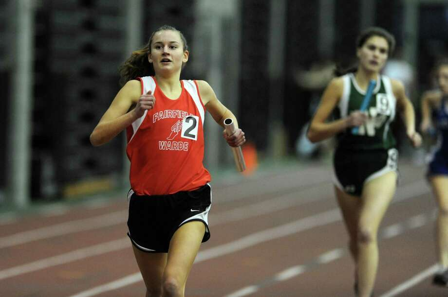 Fairfield Warde's Cate Allen races in the 4x800 meter run Thursday, Jan. 31, 2013 during the FCIAC indoor track championships at the Floyd Little Athletic Center at Hillhouse High School in New Haven, Conn. Photo: Autumn Driscoll / Connecticut Post