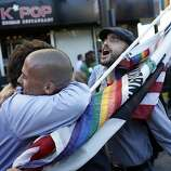 Frank Capley-Alfano is hugged by Paul Hogarth after seeing each other during celebrations in the Castro in San Francisco, Calif. on June 26, 2013.