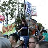 Hundreds of people gathered with signs and flags in celebration of the dismissal of the appeal of Proposition 8 and DOMA was ruled unconstitutional in the Castro in San Francisco, Calif. on June 26, 2013.
