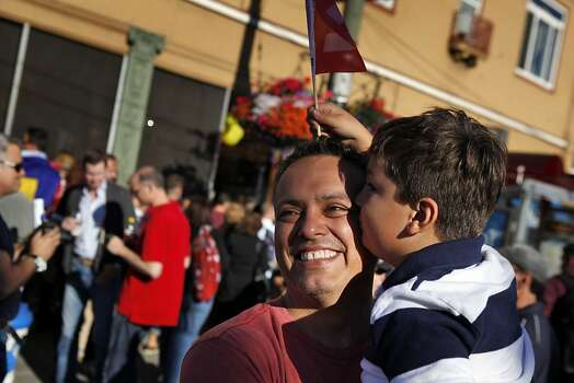 Albert Santos gets a kiss from his friend's son, Sam Destin, 6, as they celebrate the Supreme Court's decisions on DOMA and same-sex marriage in California. Thousands gathered in the Castro district of San Francisco, Calif., on June 26, 2013, to celebrate the dismissal of the appeal of Proposition 8 by the U.S. Supreme Court. Photo: Carlos Avila Gonzalez, The Chronicle