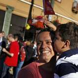 Albert Santos gets a kiss from his friend's son, Sam Destin, 6, as they celebrate the Supreme Court's decisions on DOMA and same-sex marriage in California. Thousands gathered in the Castro district of San Francisco, Calif., on June 26, 2013, to celebrate the dismissal of the appeal of Proposition 8 by the U.S. Supreme Court.