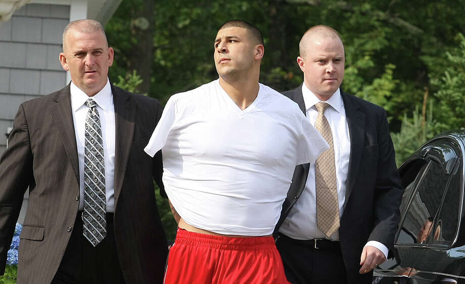 On June 26, 2013, New England Patriots tight end Aaron Hernandez was arrested and charged with the shooting death of an acquaintance near his home in Massachusetts. He has not admitted guilt and is awaiting prosecution. The team immediately cut ties with him. In light of the recent attention on the crime, here's a look at homicide scandals in the sports world over the years. Photo: Boston Globe, Boston Globe Via Getty Images / 2013 - The Boston Globe