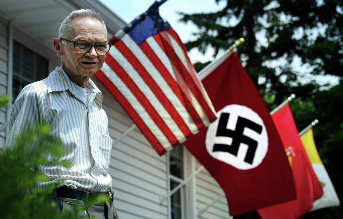 Joseph Sincavage stands on the steps of his Stratford, Conn. home where he has been flying a Nazi flag he says in protest of President Barack Obama.
