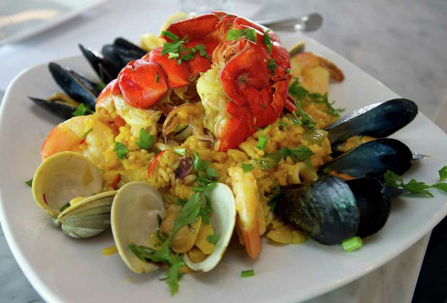 """Classic Paella"" with shrimp, lobster, clams, mussels, calamari, scallops, chorizo and chicken at Dolce Cubano in Stamford, Conn., on Tuesday, June 25, 2013. Photo: Lindsay Perry / Stamford Advocate"
