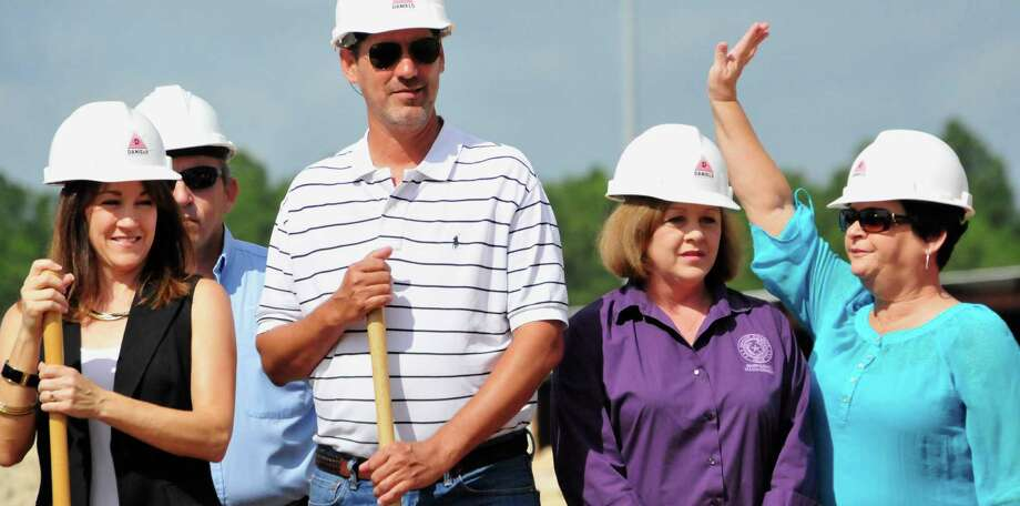 Lumberton city and school officials gathered June 27 for a groundbreaking of the new FEMA Dome. The safe room will have a capacity for 1,133 and double as a Fine Arts Center, with room for a 1,500-seat auditorium, or convention center. The dome is being built between Lumberton High School and Lumberton Intermediate School. Photo: Cassie Smith